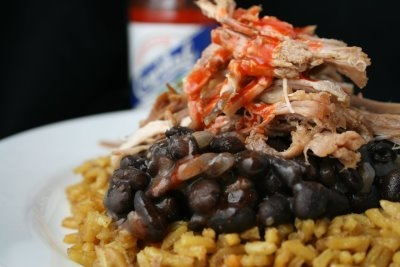 roast pork with black beans and yelow rice